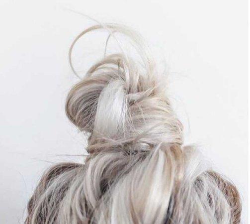 white hair messy bun top knot bleach blonde bleached pale hair hairstyle albino platinum cream creamy