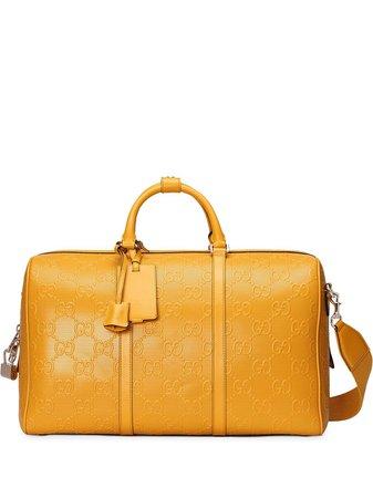 Gucci GG-embossed duffle bag - FARFETCH