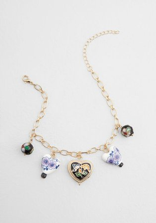 Quite the Collection Charm Bracelet in Gold/Multi | ModCloth