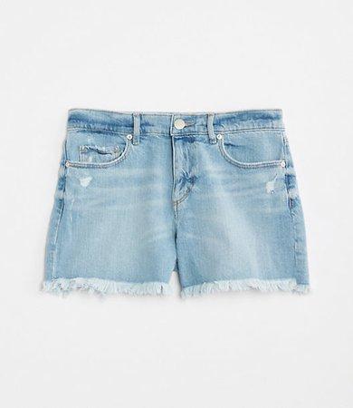 Destructed Denim Cut Off Shorts in Light Indigo Wash