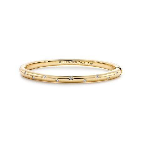 Etoile bangle bracelet in 18k gold with round brilliant diamonds, medium