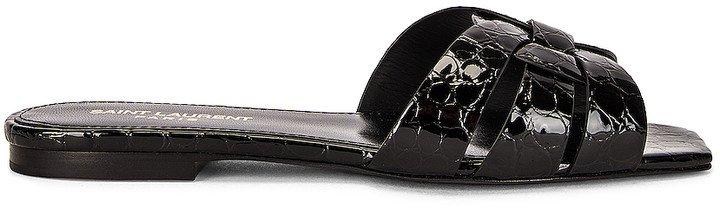 Tribute Flat Sandals in Noir | FWRD