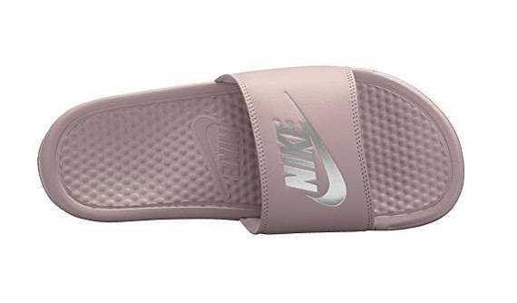 Rose gold Nike slides