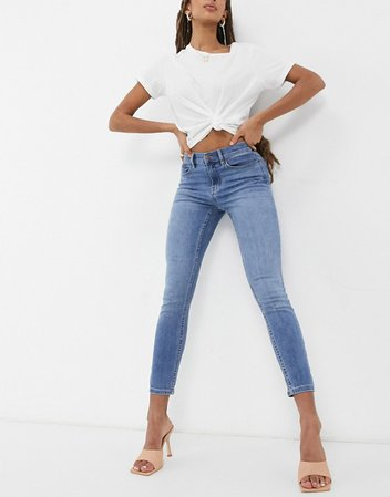 Calvin Klein Jeans mid rise skinny jeans in mid wash | ASOS