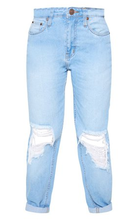 The Petite Mid Wash Distressed Knee Straight Leg Jeans. Head online and shop this season's range of petite at PrettyLittleThing. Express delivery available.   PrettyLittleThing