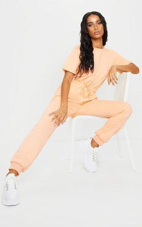 Peach Short Sleeve Sweat Jumpsuit | PrettyLittleThing
