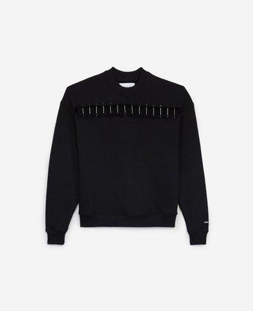 Roomy black sweatshirt with cut and piercing   The Kooples