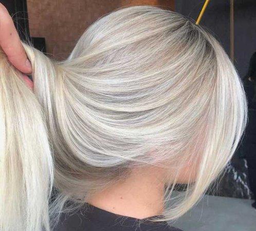 bleach blonde light platinum dark brown roots hair color