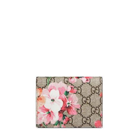 GG Blooms card case in Beige/ebony GG Supreme canvas with Blooms print, a material with low environmental impact | Gucci Women's Wallets & Small Accessories