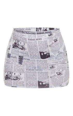 Cream Newspaper Printed Mini Skirt | Skirts | PrettyLittleThing
