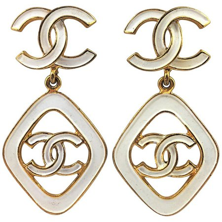 Vintage Chanel 2.5 Inches Long White Enamel on Gold Tone Metal Earrings For Sale at 1stdibs