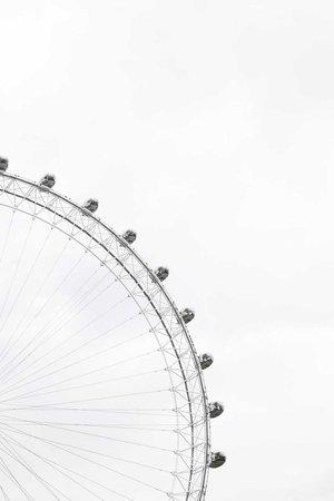 Ferris wheel in a cloudy sky photo by Adam Birkett (@abrkett) on Unsplash