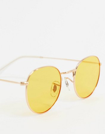 A.Kjaerbede round sunglasses in gold with yellow lens | ASOS