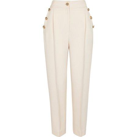 Cream button front peg trousers   River Island