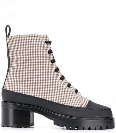 Nicole Saldaña checked ankle boots