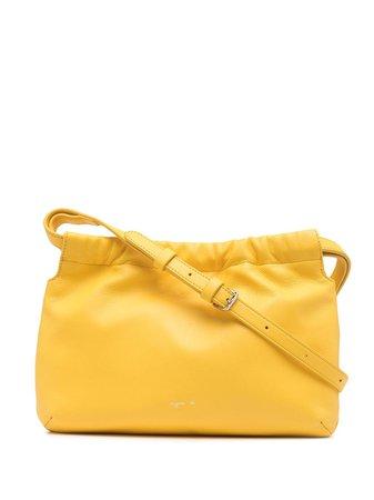 Shop yellow agnès b. drawstring shoulder bag with Express Delivery - Farfetch