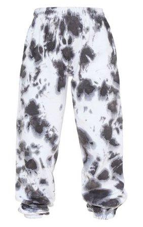 Petite Black Oversized Tie Dye Jogger | PrettyLittleThing