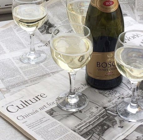 newspaper and champagne