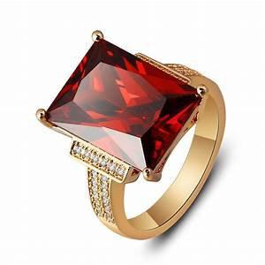 golden rectangular red stone ring