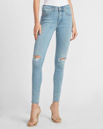 Mid Rise Ripped Raw Hem Skinny Jeans