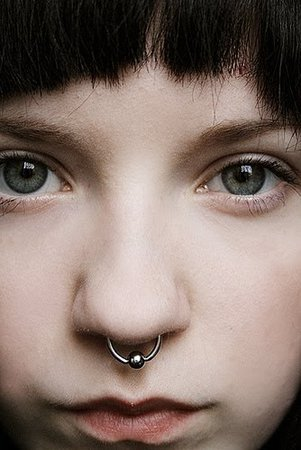 Septum nose ring piercing