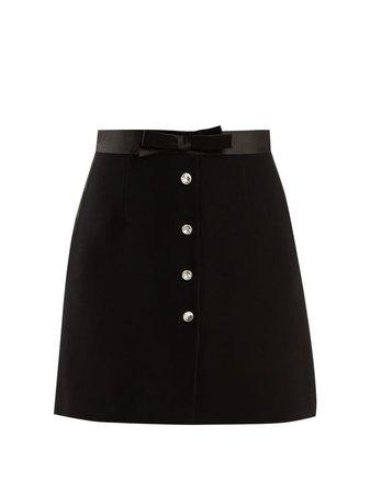 black skirt miu miu