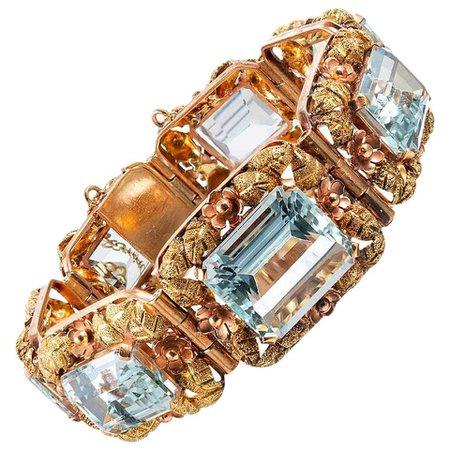 Tri-Color Gold Floral Motif Bracelet with Aquamarine For Sale at 1stDibs