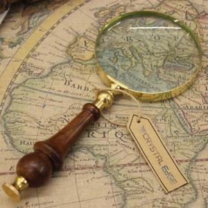 map and vintage magnifying glass