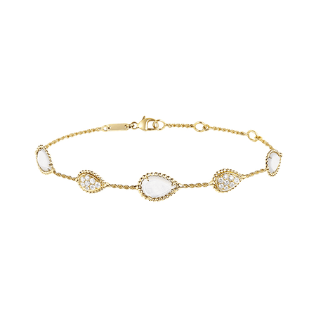 Boucheron, SERPENT BOHÈME BRACELET, FIVE MOTIFS Five-motif bracelet set with white mother-of-pearl and round diamonds, in yellow gold