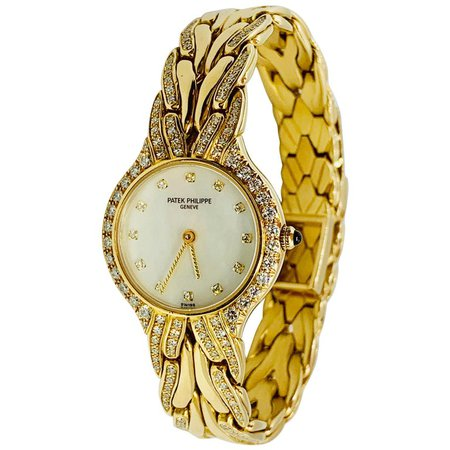 Patek Philippe Diamond and 18 Karat Yellow Gold La Flamme Ladies Watch For Sale at 1stdibs