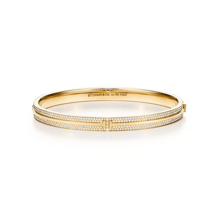 Tiffany T pavé diamond hinged bangle in 18k gold, medium. | Tiffany & Co.