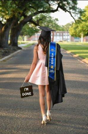 Graduate in pink dress - google