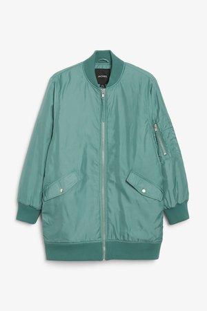 Oversized bomber jacket - Pistachio green - Coats & Jackets - Monki WW