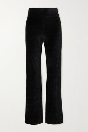calé | Angelique stretch-velour flared pants | NET-A-PORTER.COM