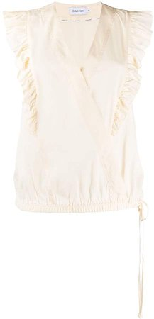 sleeveless wrap front blouse