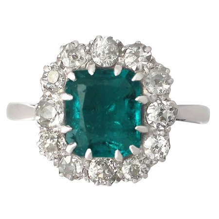 1910s Antique 1.62 Carat Emerald and Diamond Platinum Cluster Ring For Sale at 1stdibs