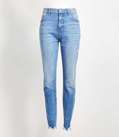 High Rise Chewed Hem Skinny Jeans in Vintage Wash   LOFT