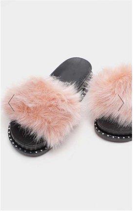 light pink fur slides.