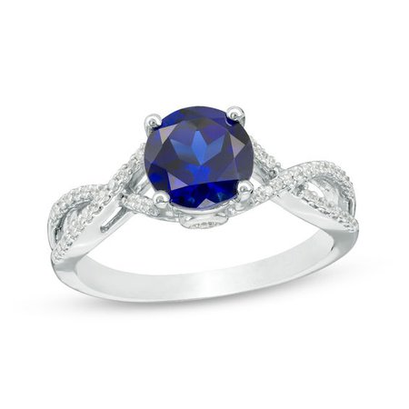 7.0mm Lab-Created Blue Sapphire and 0.145 CT. T.W. Diamond Twist Shank Engagement Ring in 10K White Gold | View All Wedding | Wedding | Peoples Jewellers