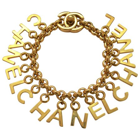 CHANEL Turnlock CC Gold Charm Bracelet For Sale at 1stdibs