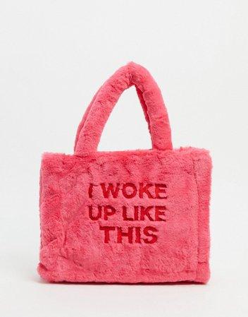 Skinnydip small tote bag in pink faux fur | ASOS