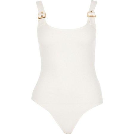 Cream sleeveless buckle strap bodysuit | River Island