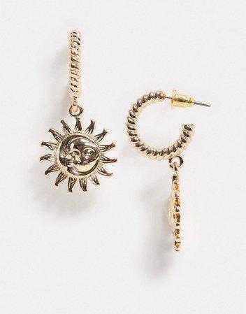 ASOS DESIGN twist hoop earrings with sun charm in gold tone | ASOS