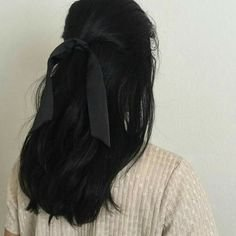 brown hair tied with black ribbon aesthetic