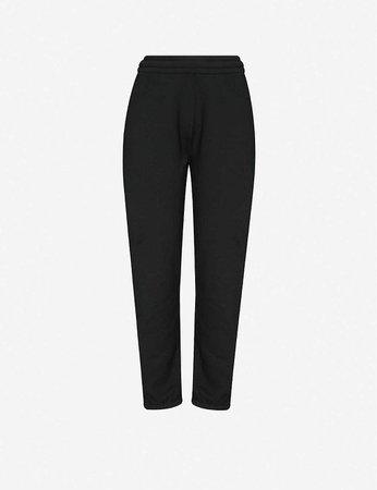 ACNE STUDIOS - Tapered cotton-jersey jogging bottoms | Selfridges.com