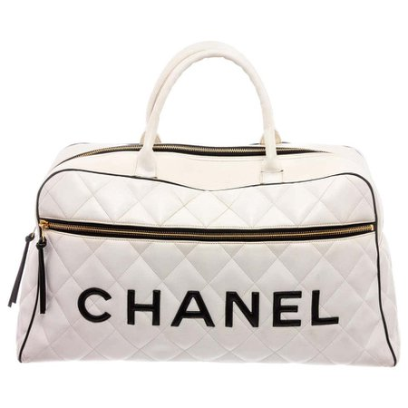 Chanel Vintage White Quilted Leather Black Logo Duffle Bag For Sale at 1stdibs