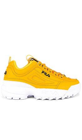 Fila Disruptor II Premium Sneaker in Gold, Black & White | REVOLVE