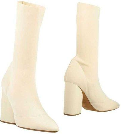 heeled beige boots