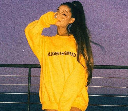 ariana grande yellow sweater