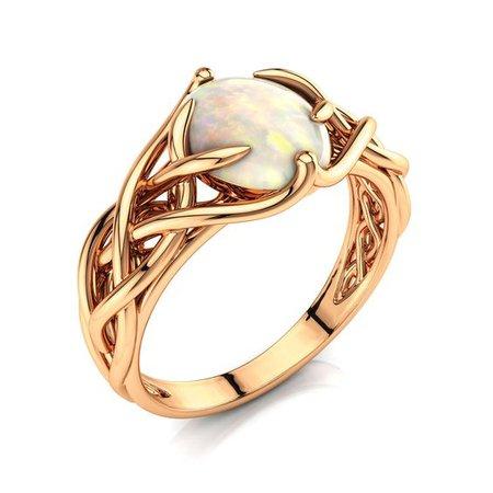 gold Celtic ring opal